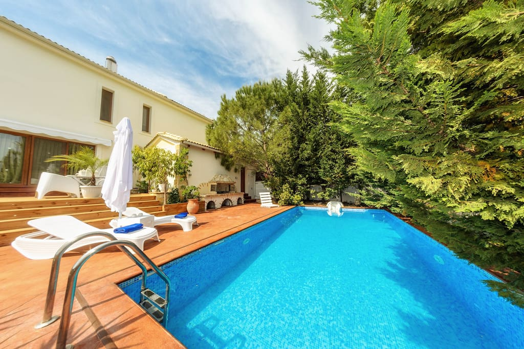 Swimming pool area with sunbeds, umbrellas & outdoor BBQ facilities