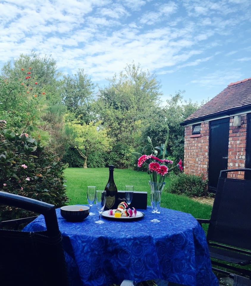 Rear enclosed garden with BBQ.