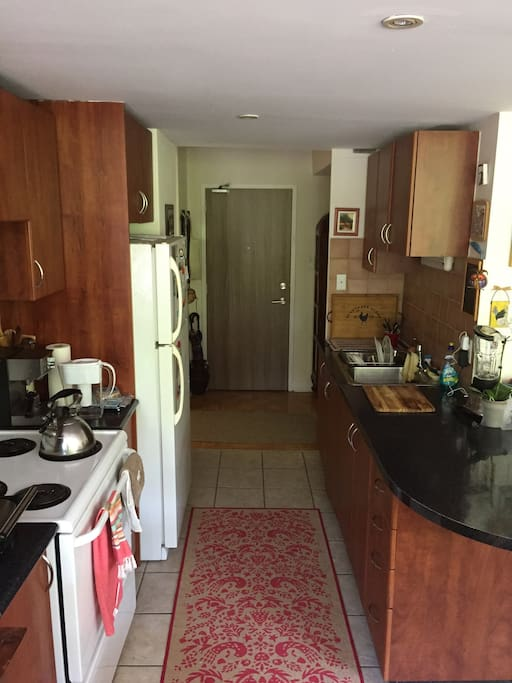 Kitchen with all appliances included (blender, panini press, espresso machine, etc)