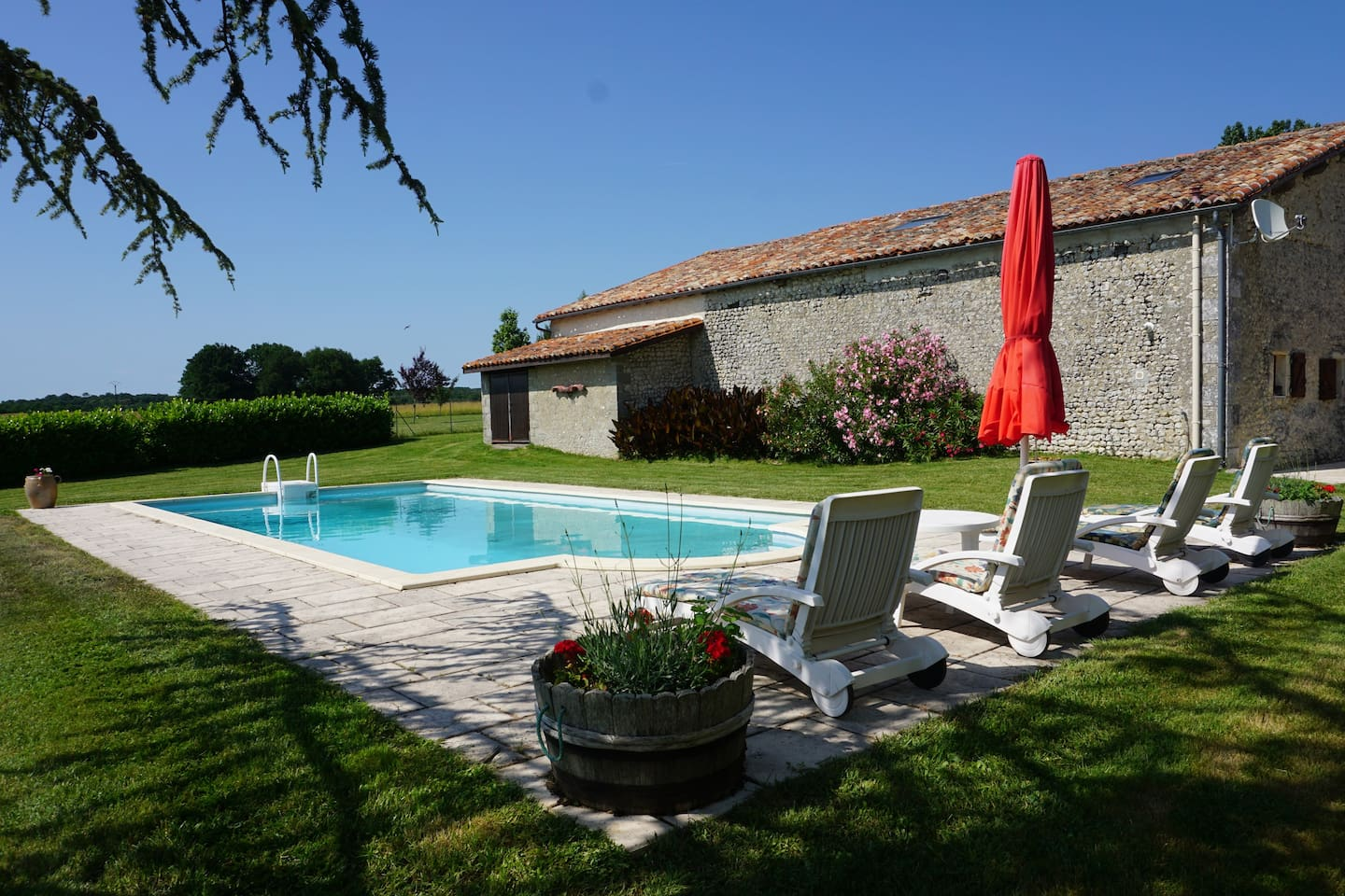 Private swimming pool with terrace and views across the countryside