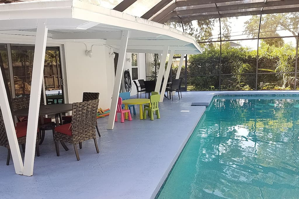 Pool Deck with Screen Enclosure; seating for 14