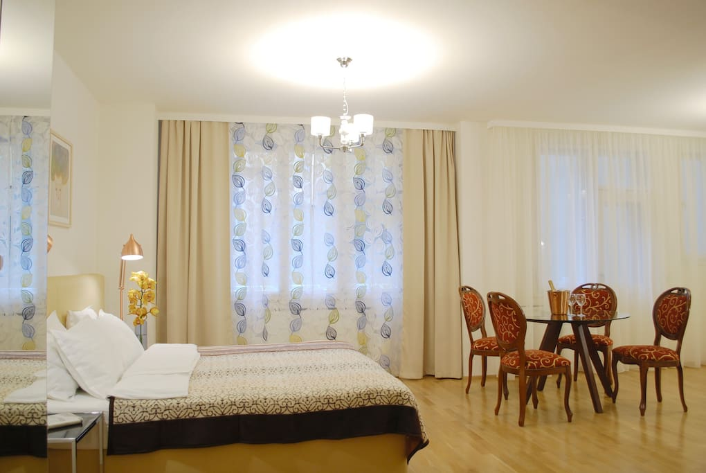 The main room is very spacious, with a big bed, convertable single bed, waredrobe and a dining table.