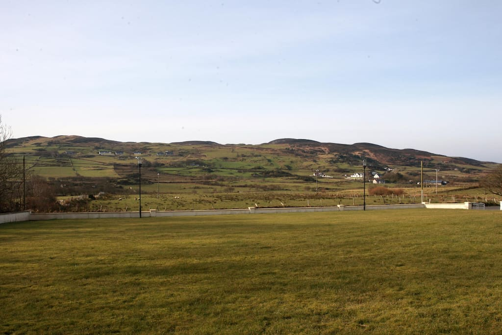 Views of front garden and hills beyond
