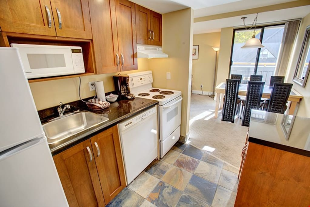 The kitchen has all the amenities you'd ever need during your stay!