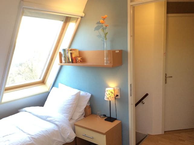 Breda N-W, blue private room, bed, desk, bike
