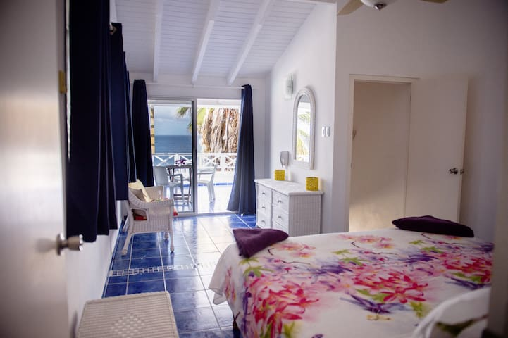 View on the porche and the ocean from the bed