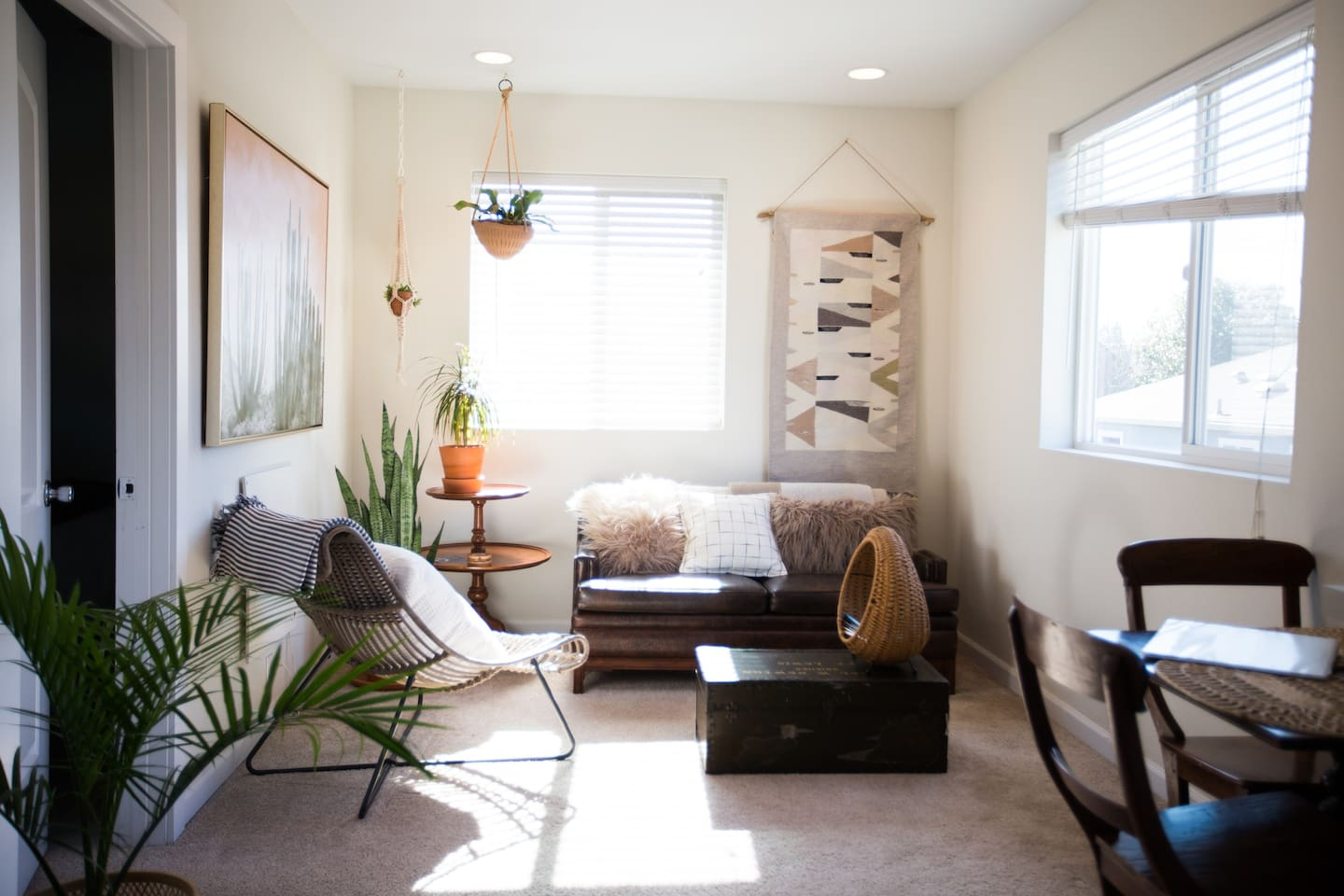 We've utilized every inch of this cozy, small space. The living room is comfy, bright, and has a mix of new & vintage finds.