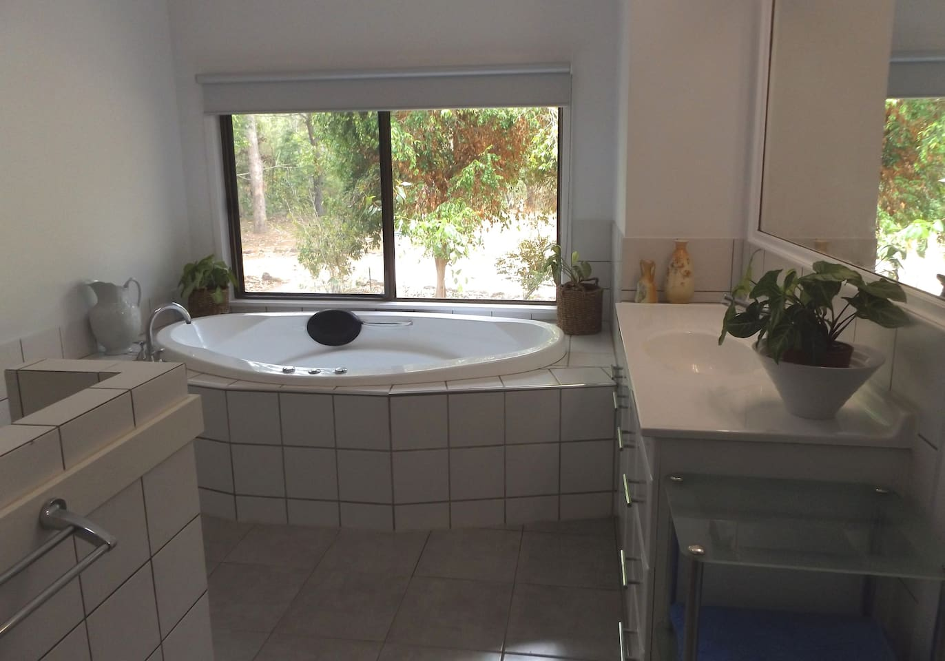Bathroom with spa and no see through roller blind.