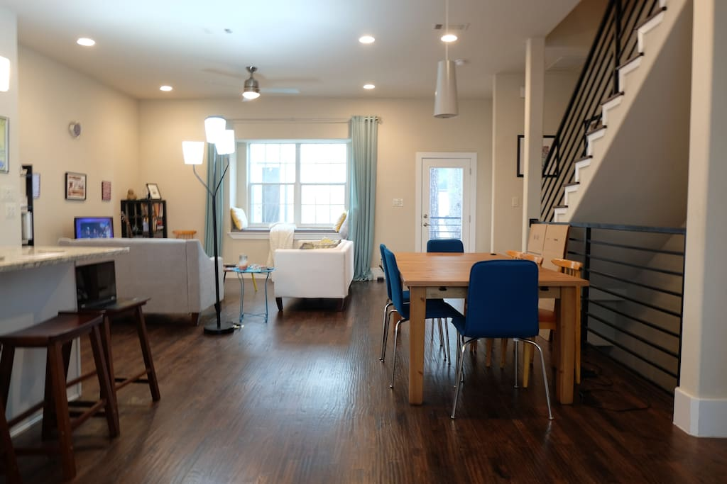 Shared living area includes two couches, cozy window seat, and TV with access to netflix/amazon instant video