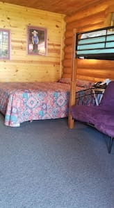 Queen bed plus bunk bed with twin on top, futon on bottom.  Futon folds out to a double bed.