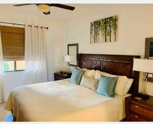 """King Size Master Bedroom has a 50"""" TV with large night stand storage chests, bureau and walk in closet.  Our lamps provide you with USB ports for mobile phones and Ipads"""