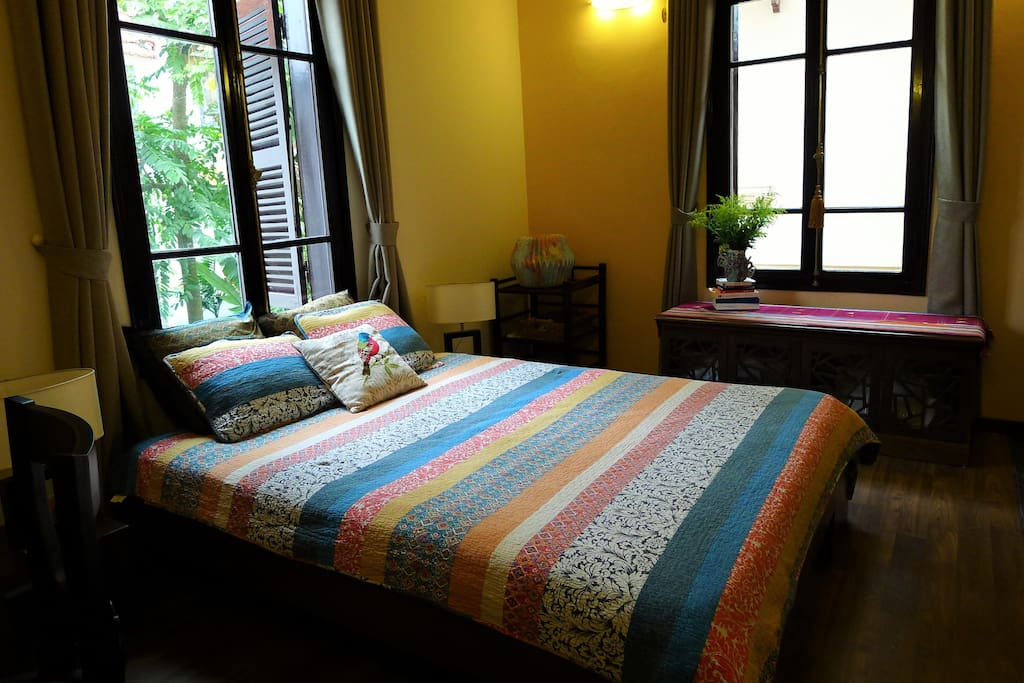 Comfortable queen mattress and clean, 100% cotton bedding. Two bright windows, both with shutters and curtains.