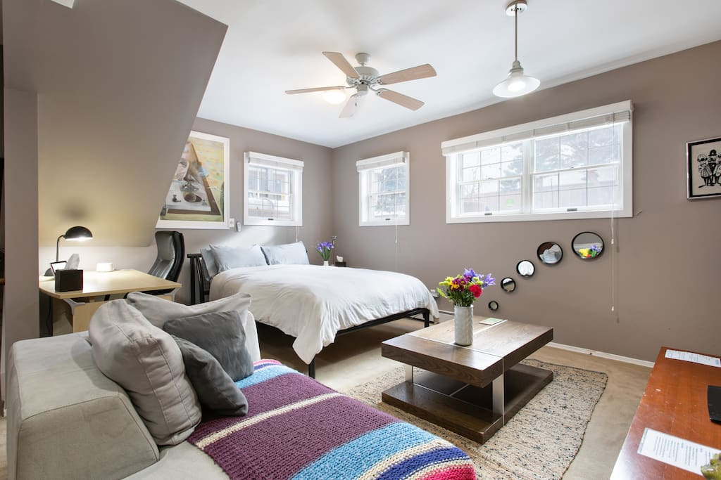 Super comfy queen bed with plenty of windows for great lighting!