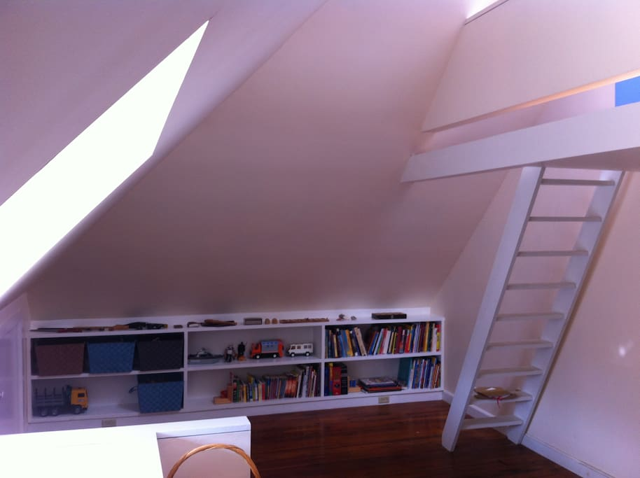 This is our third floor which has two bedrooms, a brand-new bathroom, and a loft with a skylight.