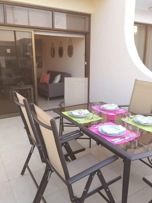 Large outdoor veranda with table and chairs for 6 plus umbrella - sea view