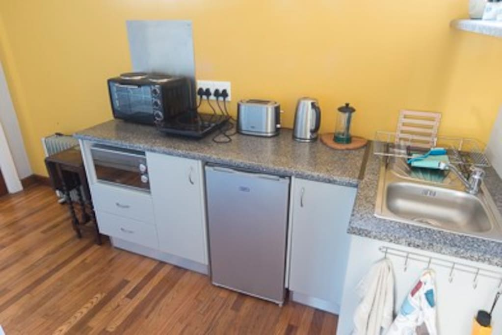 Well equipped with mini oven, induction hob, toaster, kettle, fridge, microwave, sink and full range of equipment for proper self catering