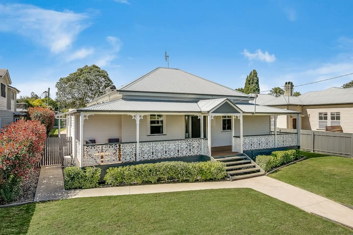 Renovated Queenslander next to Queen's Park