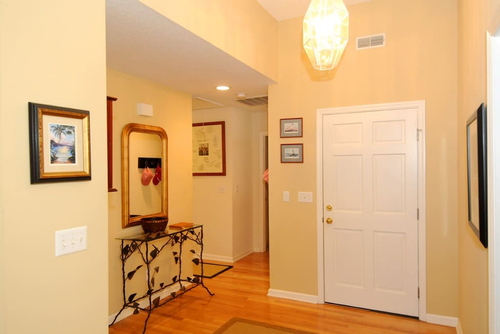 FRONT HALL Wide entrance will table and basket to organize keys when entering.