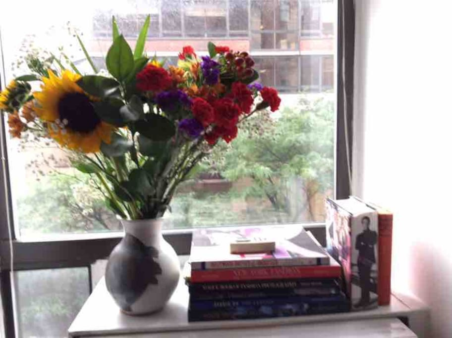 A room with a view and fresh flowers with lovely books for your comfort pleasure.
