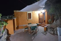 Second external space at night, next to shower and back entrance. The table will be replaced by an extendable one (1.6m-2.0m) that can accommodate 6+ people.
