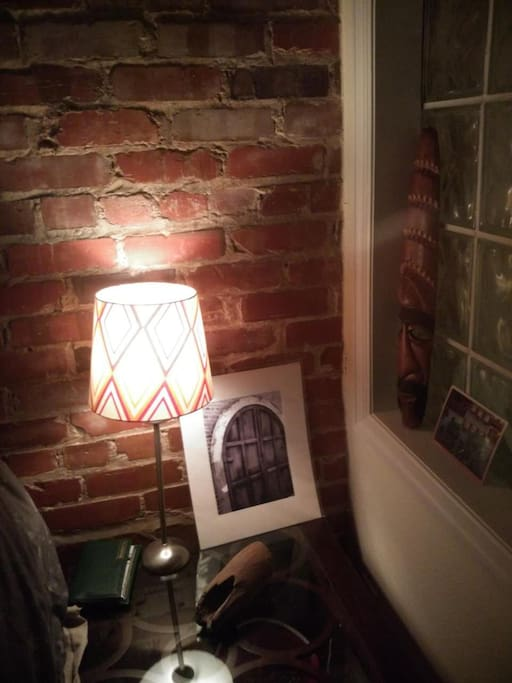 The glass block window glows at night from the neighbors lights. It's an awesome and huge night light.