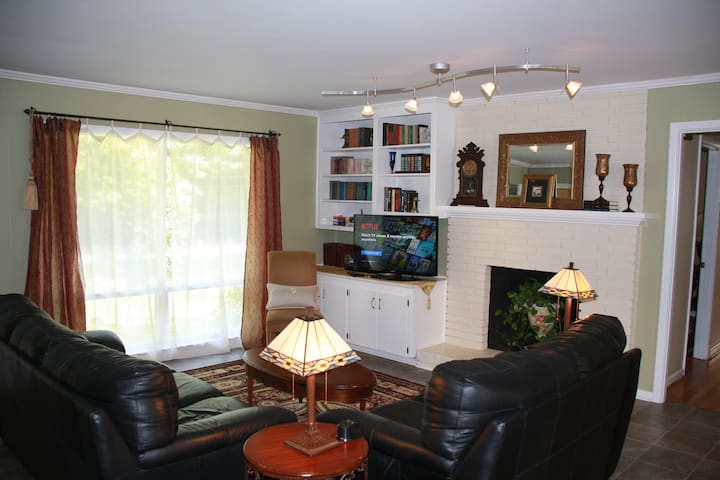 Den features Comfy chairs/ Sofa and a SmartTV/DVD that you can use to watch a movie. Sorry, no Cable TV.