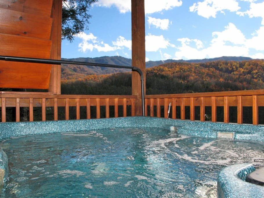 It doesn't get better than this! - Luxuriate in the deck's hot tub and watch the clouds float above the mountaintops or search fo