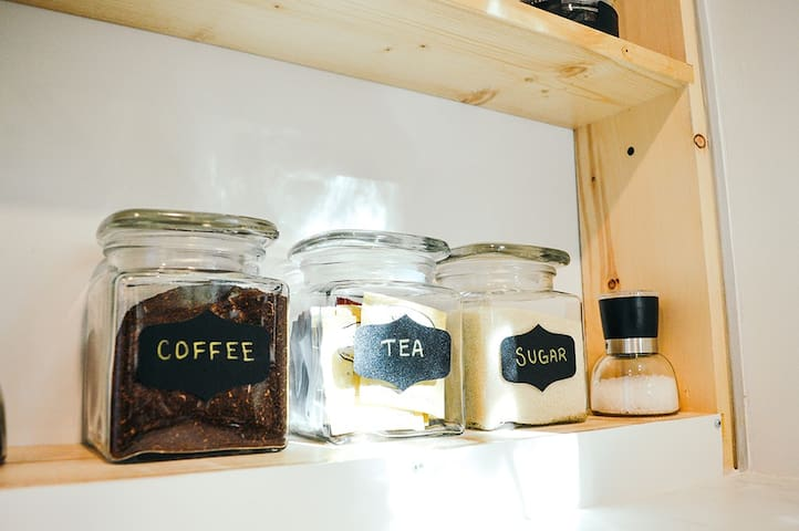 Locally roasted beachcomber coffee, a selection of teas, and organic sugar