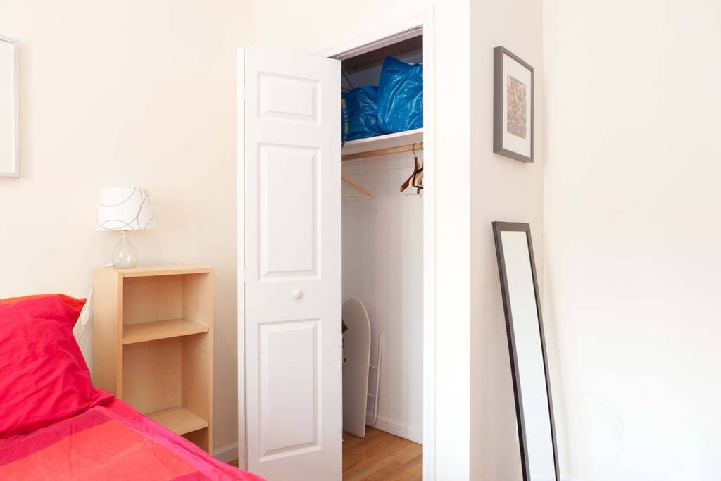 The bedroom features ample closet space.