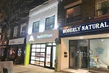 The building at night, along a vibrant area of the East Danforth. Very close to Woodbine subway station, restaurants, coffee shops, groceries and all shopping.