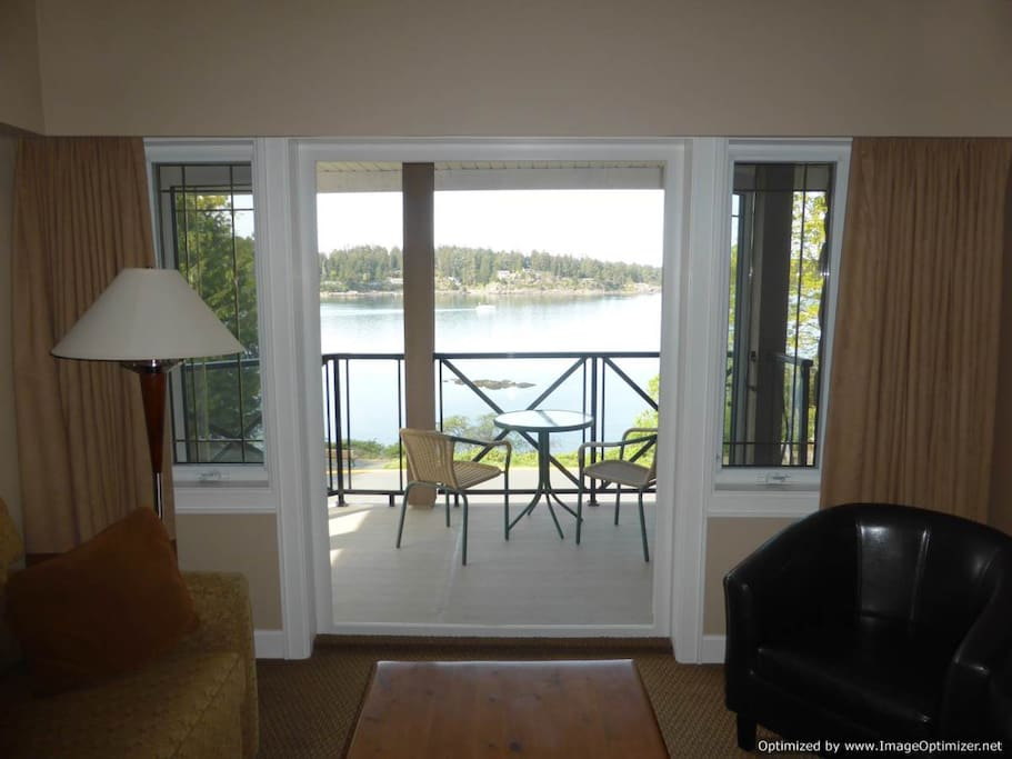 Enjoy a beautiful view from the living room or sit outside on the wrap around balcony