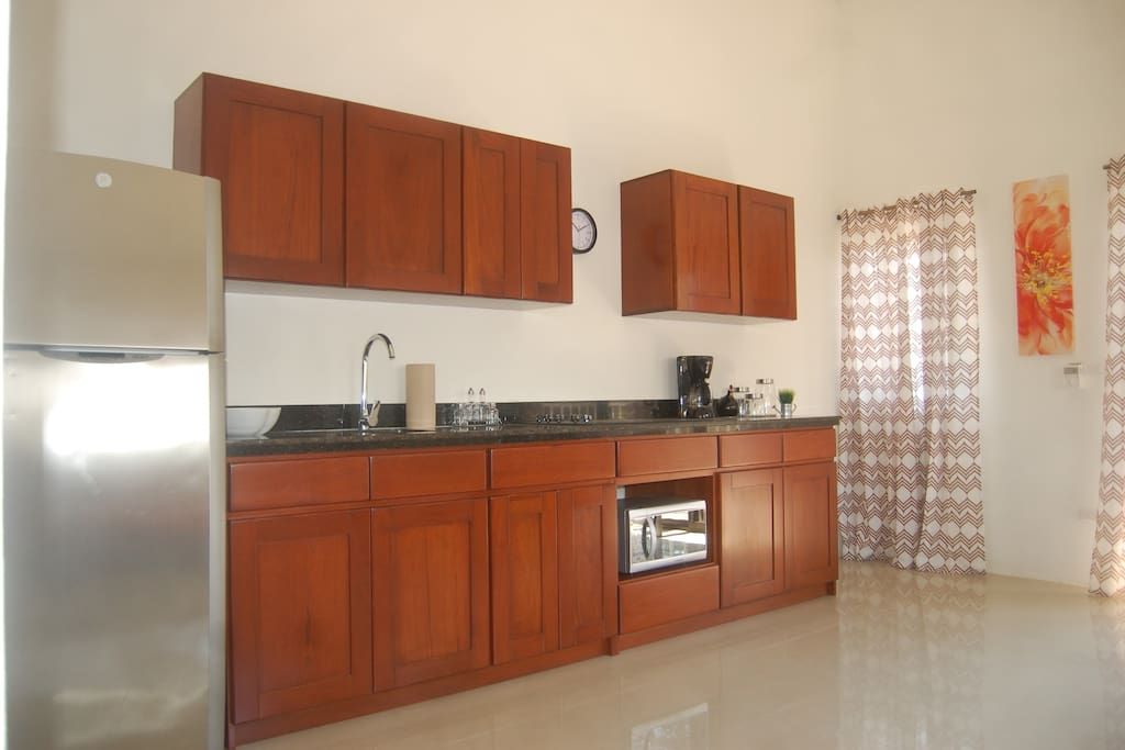 Kitchen with Coffemaker, Stove, Microwave, water heater and lot more