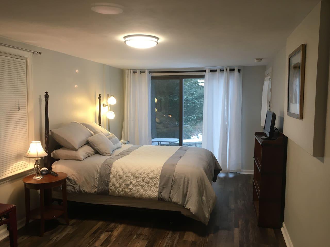 Queen size bed with Sliding Glass door view