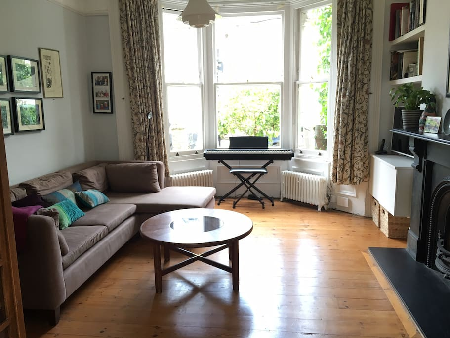 Front sitting room with digital piano and smart TV