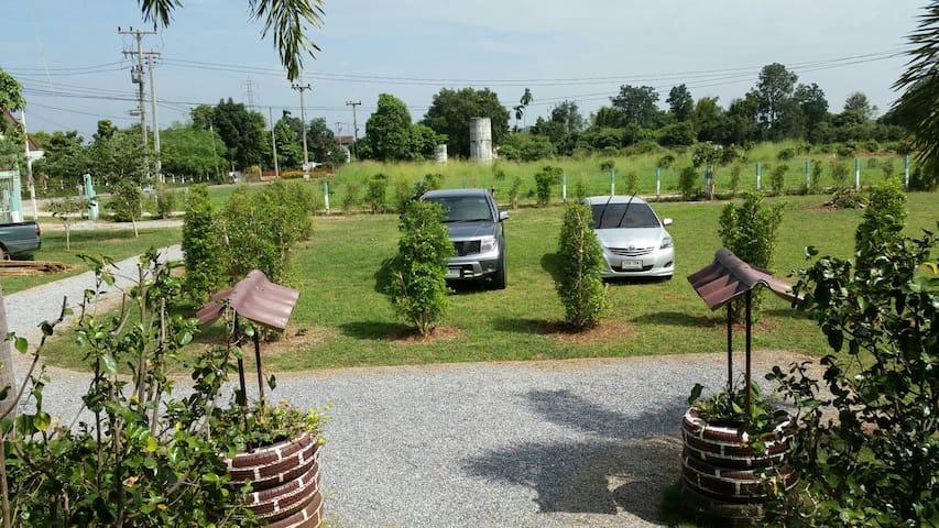 open concept garden with carpark and garden sitting.