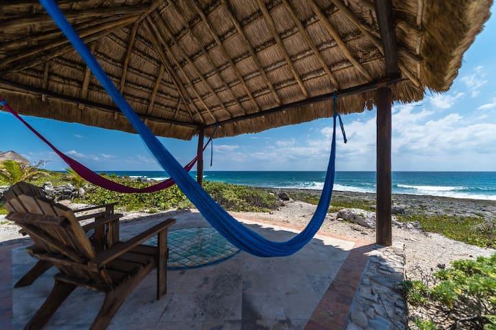 Casa Iguana's oceanside shade palapa.