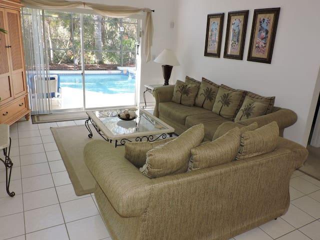 Main sitting room overlooks your pool