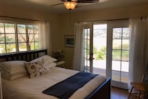 Bedroom 3 Queen bed French doors Ceiling fan  Gorgeous views