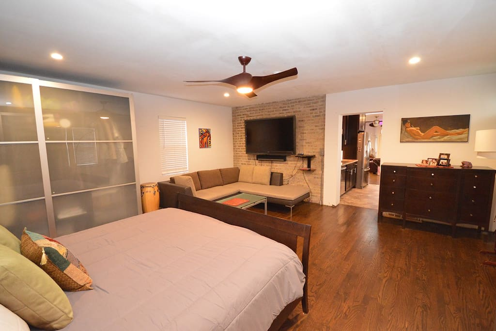 """Master Bedroom. View from bed.  60"""" Flat Screen and """"Sonos"""" sound bar."""