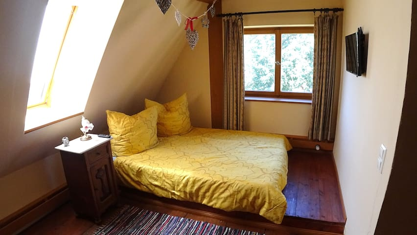 Romantic guest room in the old monastery mill
