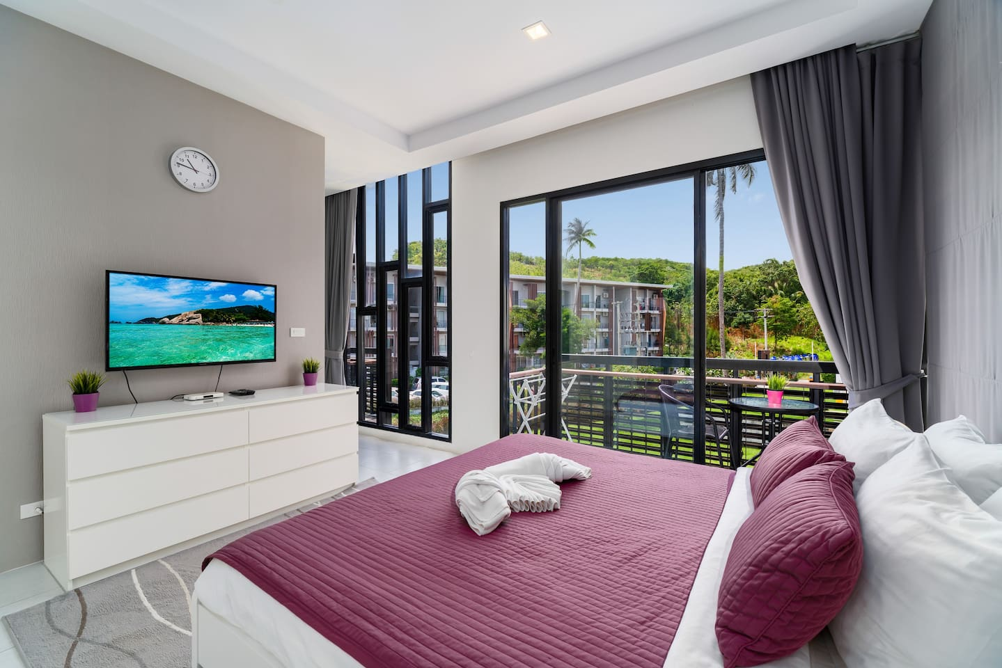 Master bedroom with balcony and private, en-suite bathroom.