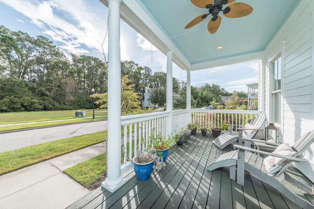 Gorgeous wrap around porch big complete with table for 8 and quiet reflecting area, southern fans