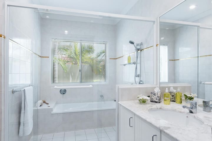 Private Bathroom with shower and bath