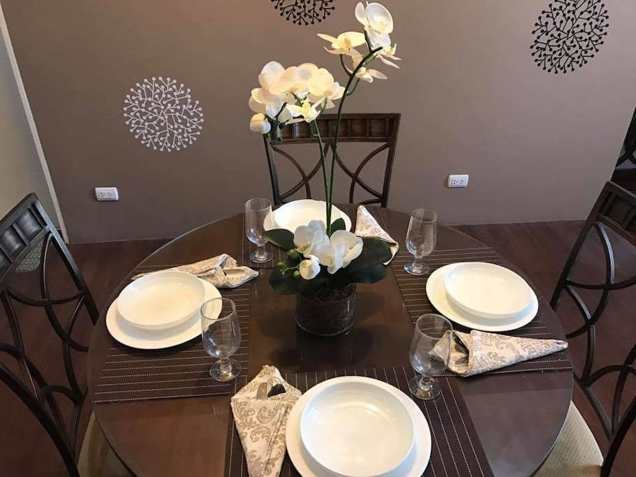 The Dining Table. Guests can devour a scrumptious meal using the utensils provided.