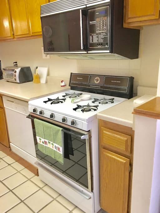 This kitchen comes with pots and pans,coffee machine toaster. Everything you need for cooking .