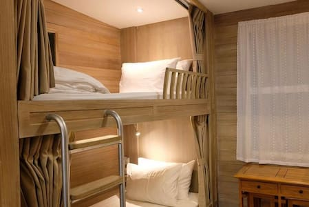 Bunk beds with blackout curtains. Rate/ 1 bed