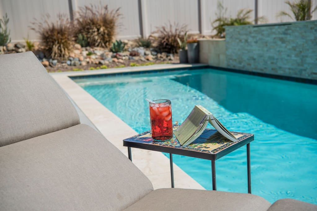 Relax poolside with a book and drink