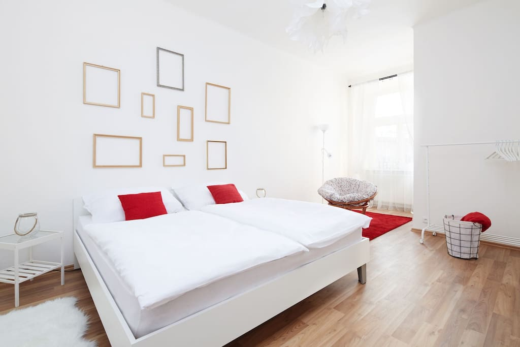 The apartment consists of two bedrooms; this one is delicately decorated with golden frames. Together with red patches here and there, this creates very warm and pleasant atmosphere.