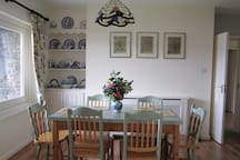 The dining table, overlooking the lake, seats five.