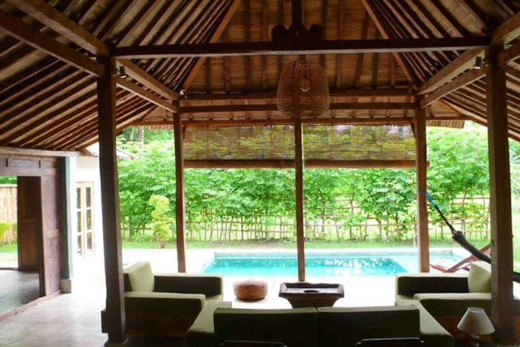 Traditional Javanese  teak house, over 150 years-old and refurbished combining locally sourced materials and elements of modern luxury.